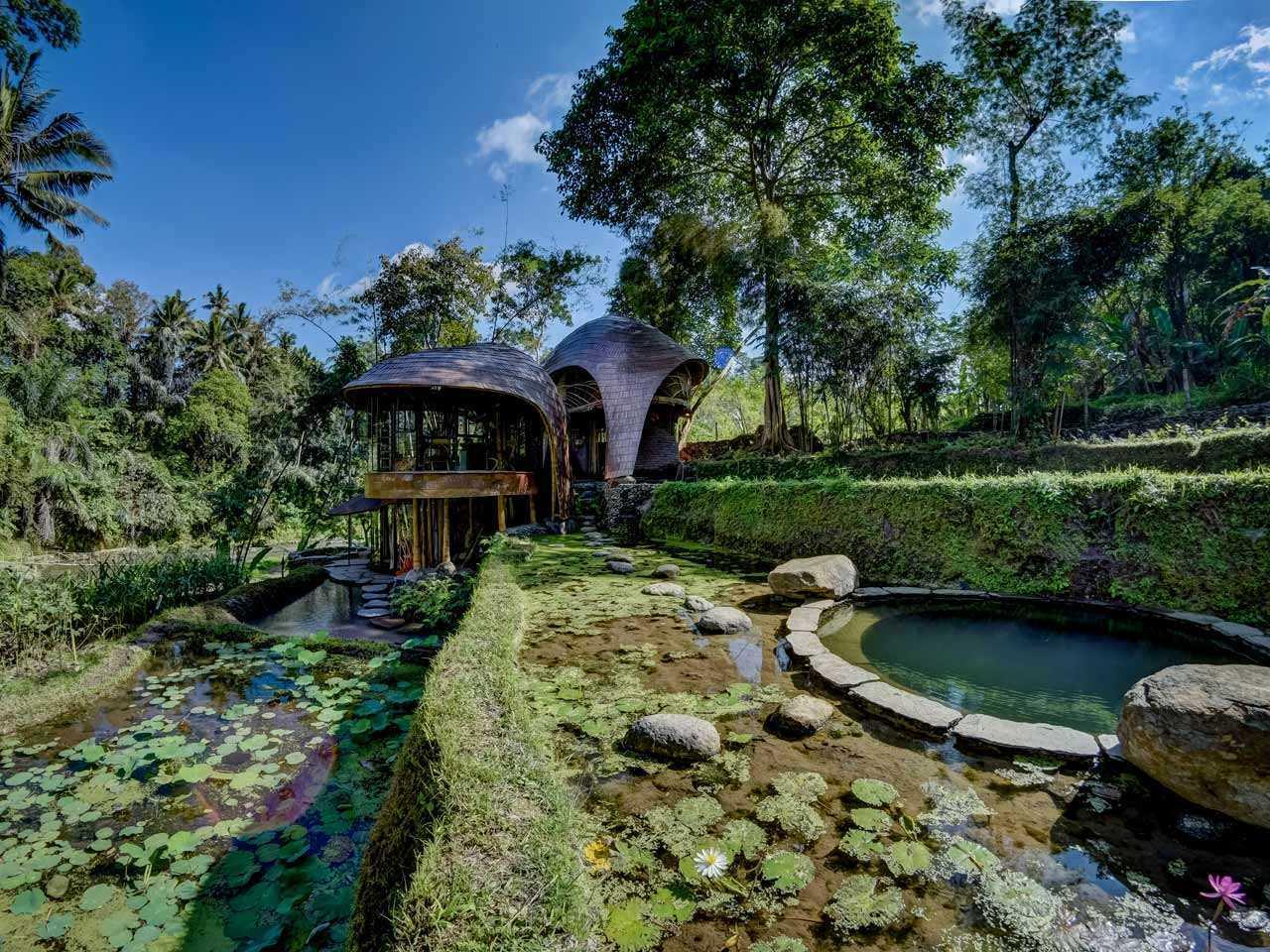 Agung Budi Raharsa | Architecture & Engineering Riverbend Bamboo House - Bali Bali, Indonesia Bali, Indonesia Exterior View Tropical 88700