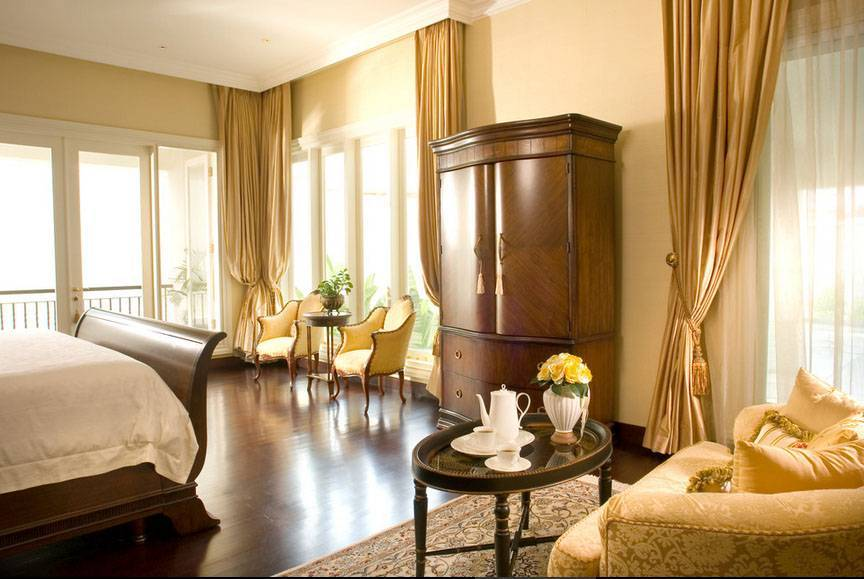 Iwan Sastrawiguna Colonial Modern Tropical Jakarta, Indonesia Jakarta, Indonesia Bedroom Tropis <P>Master Bedroom's Floor Is Covered With Walnut Brown Parquet. Armoire Is Placed In Front Of Sleigh Bed Accompanied By Two Classical Arm Chairs, Oval Coffee Table And Fabric Loveseat.</p> 6622
