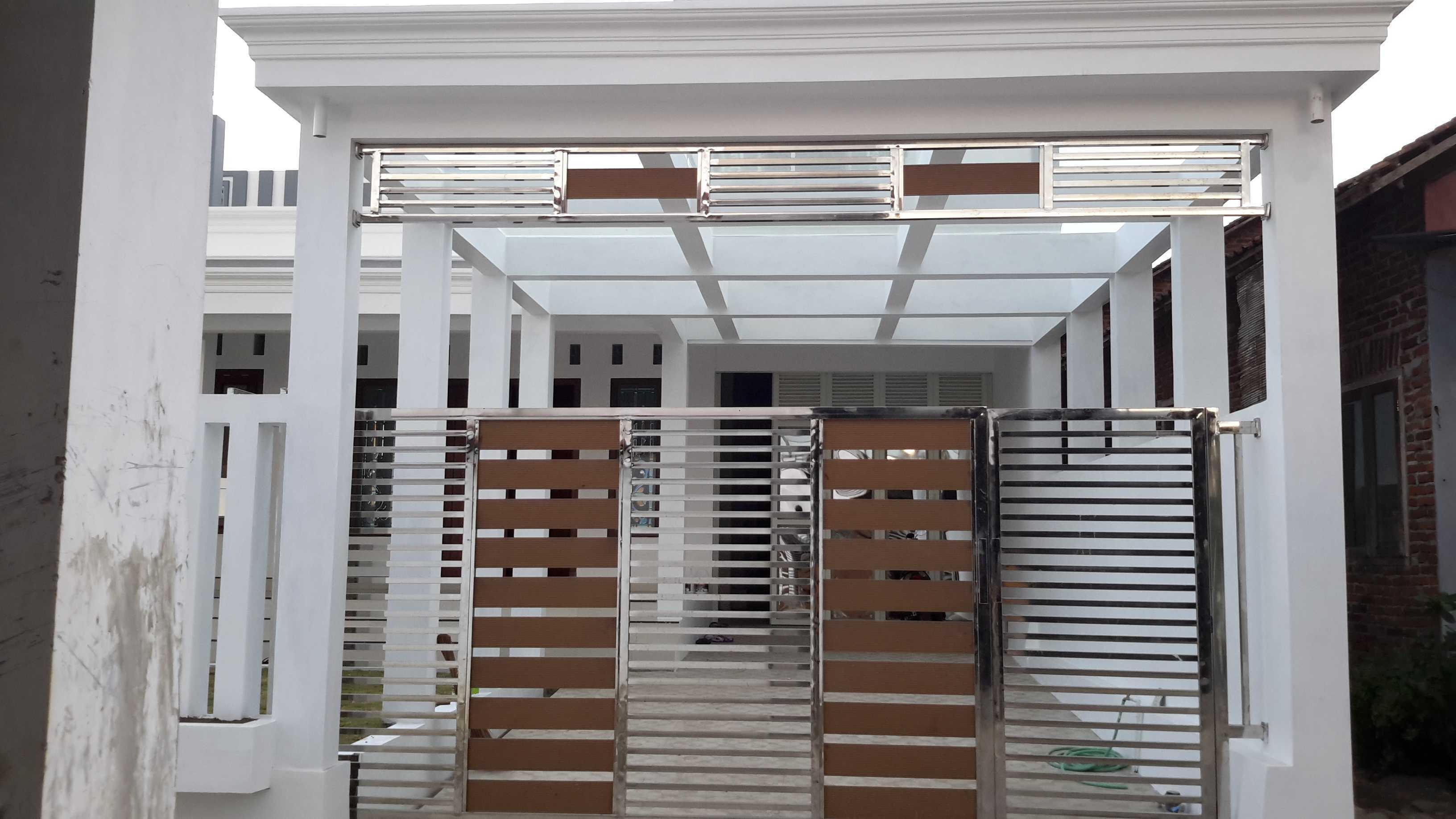 Cahaya Griya Pembangunan Rumah   Tampak Depan Minimalist Tampak Dari Depan Ruangan, Dengan Atap Canopi Dari Kaca Tempered. 43166