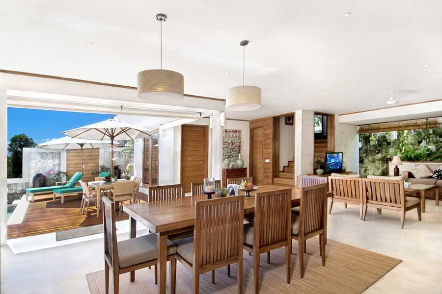 Foto inspirasi ide desain ruang makan tropis Dining area oleh IMAGO DESIGN STUDIO di Arsitag
