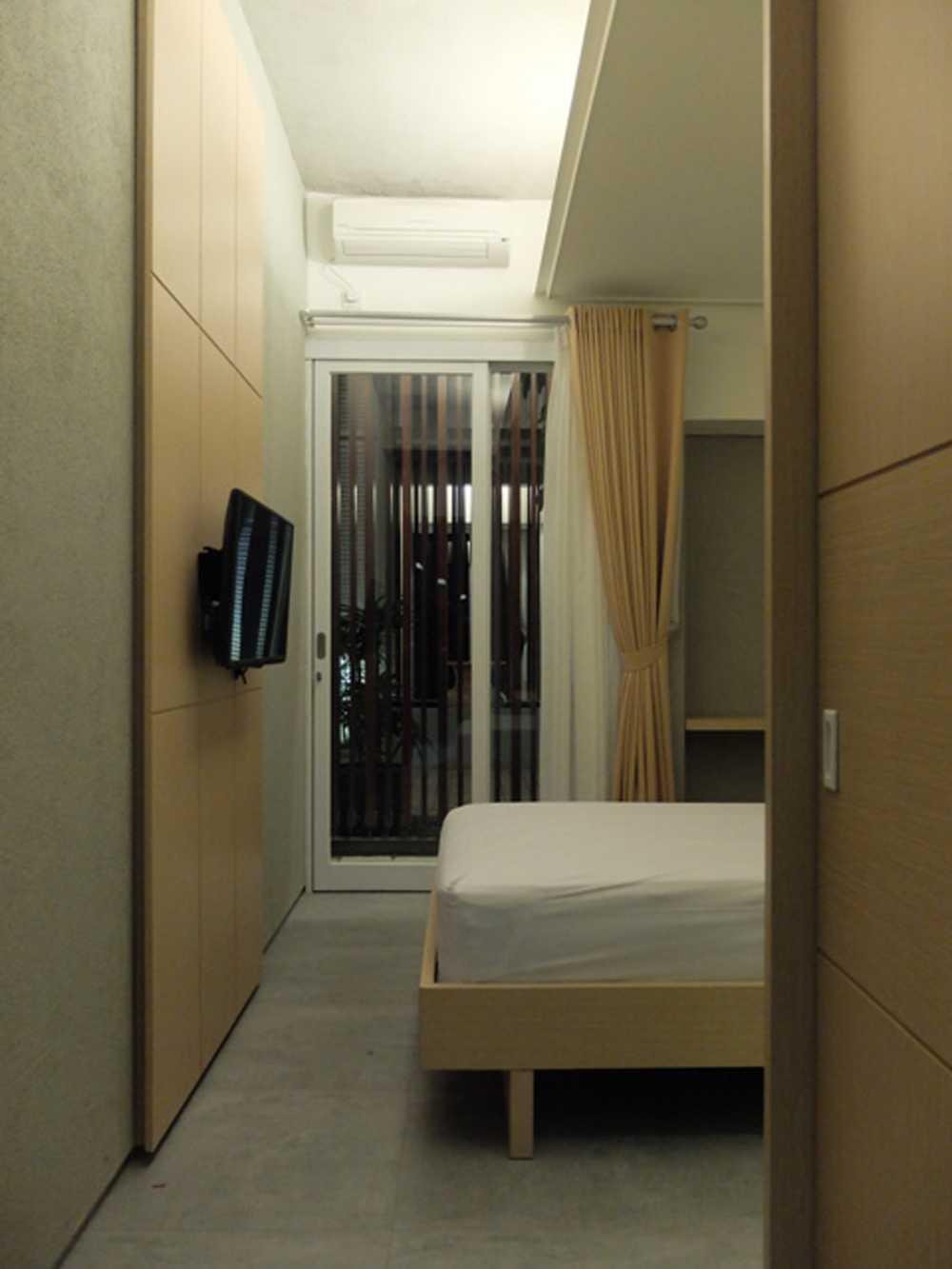 Foto inspirasi ide desain kamar tidur tropis Bed room oleh RDMA di Arsitag