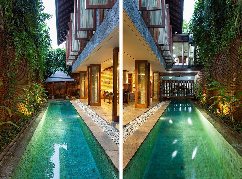 Foto inspirasi ide desain kolam tropis Swimming pool area oleh i n s p i r a t i o di Arsitag