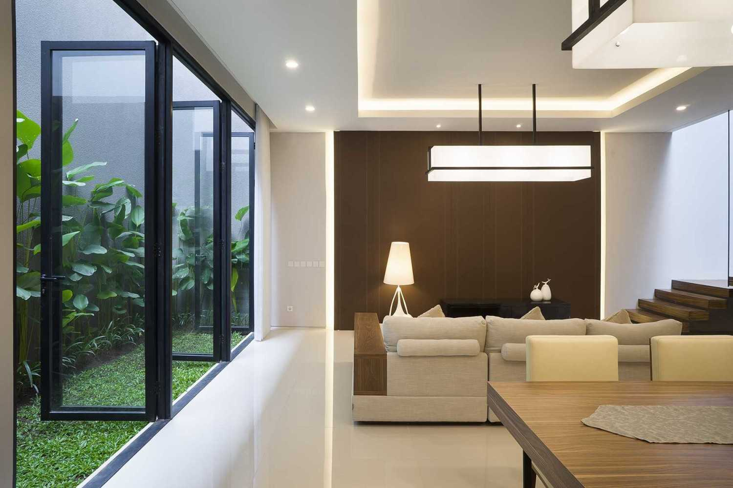 """Simple Projects Architecture """"s"""" House Pakuwon Indah, Surabaya - Indonesia Pakuwon Indah, Surabaya - Indonesia Dining & Living Area  32995"""